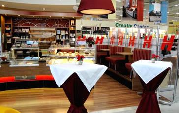 cafe plainer strasswalchen filiale im baumarkt hellweg. Black Bedroom Furniture Sets. Home Design Ideas